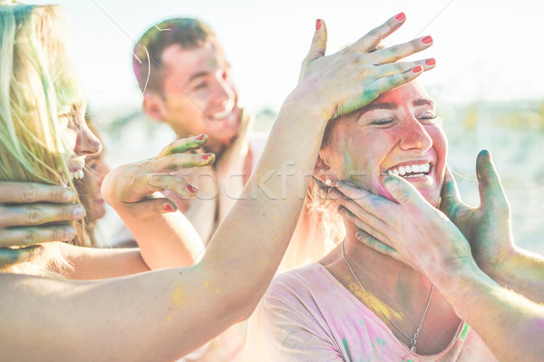 Happy friends making party with colorful powder at summer festiv Stock photo © DisobeyArt