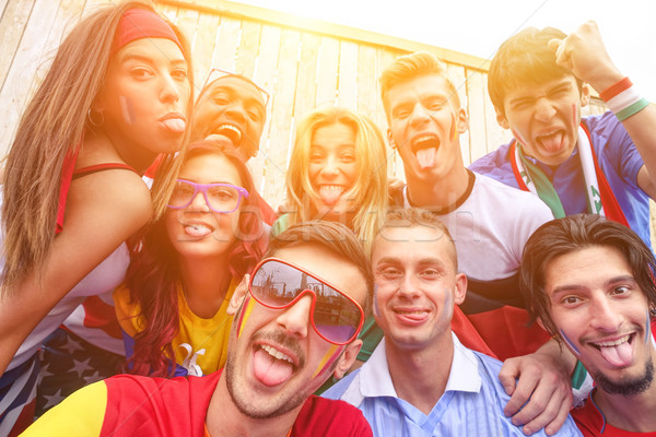 Stock photo: Multinational football supporters taking selfie outdoors - Happy