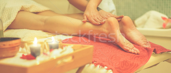 Young woman having feet therapy massage in spa resort hotel salo Stock photo © DisobeyArt