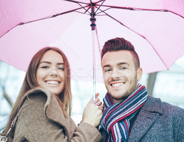 Happy lovers under umbrella around european city  - Smiling youn Stock photo © DisobeyArt