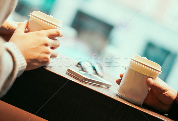 Two friends drinking coffee in paper take away cup - People havi Stock photo © DisobeyArt