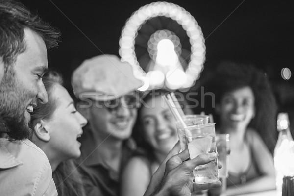 Mutlu arkadaşlar gülme plaj parti Stok fotoğraf © DisobeyArt