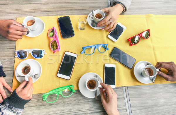 Stock photo: Group of multi ethnic friends drinking coffee at bar restaurant