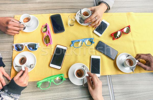 Csoport többnemzetiségű barátok iszik kávézó étterem Stock fotó © DisobeyArt