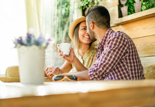 Happy couple toasting coffee and cappuccino at bar restaurant ca Stock photo © DisobeyArt