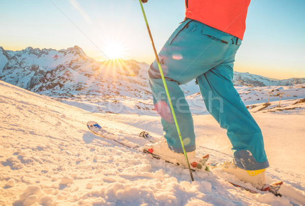 Skier having fun at sunset on top of the mountain - Legs view of Stock photo © DisobeyArt