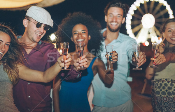 Happy crazy friends celebrating at beach 2018 new year's eve par Stock photo © DisobeyArt