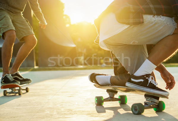 Two young skaters performing with skateboard at sunset in urban  Stock photo © DisobeyArt