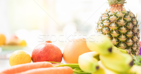 Fresh fruits in kitchen table - Diet and detox concept for a hea Stock photo © DisobeyArt