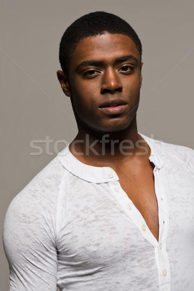 Siyah adam yakışıklı genç gündelik beyaz gömlek Stok fotoğraf © disorderly