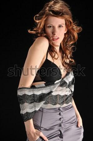 брюнетка довольно молодые черно белые блузка джинсов Сток-фото © disorderly