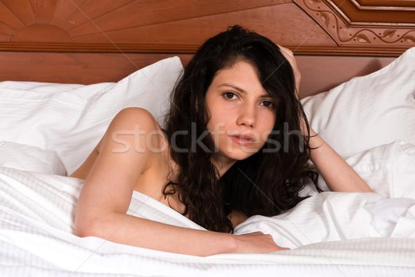брюнетка молодые ню кровать девушки Сток-фото © disorderly