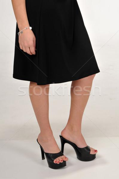 Esmer genç kadın belden aşağı etek bacaklar topuk Stok fotoğraf © disorderly