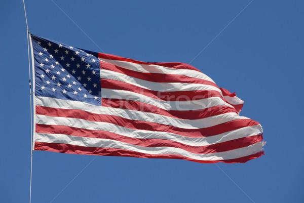 Amerikai zászló szellő csillagok kék fehér Stock fotó © disorderly