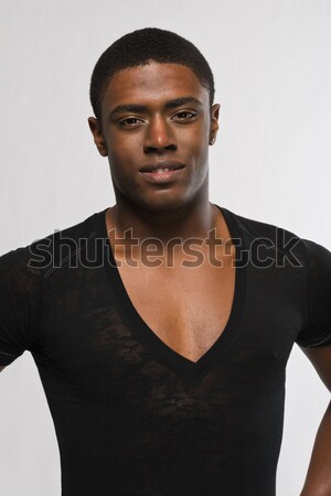 Siyah adam yakışıklı genç gündelik siyah gömlek Stok fotoğraf © disorderly