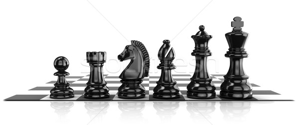 Chess black pieces, standing on board Stock photo © djmilic