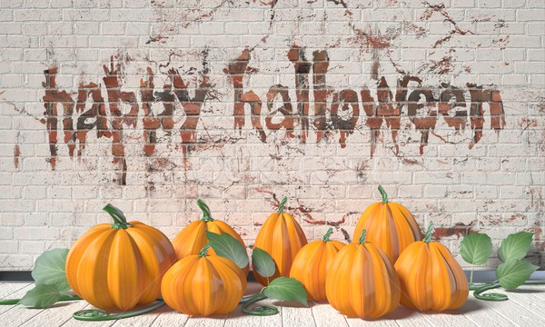 Happy Halloween greeting with pumpkins and green leafs on wooden Stock photo © djmilic