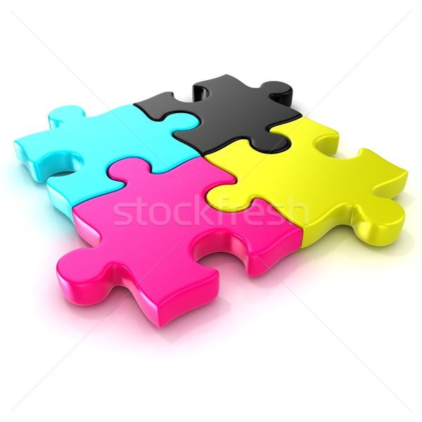 Four CMYK jigsaw puzzle pieces Stock photo © djmilic
