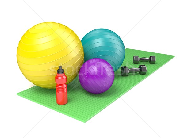 Fitness ball, dumbbells and plastic water bottle on green yoga m Stock photo © djmilic