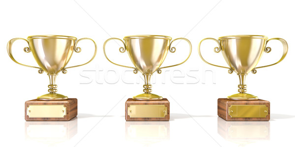 Three golden cup trophies. 3D Stock photo © djmilic