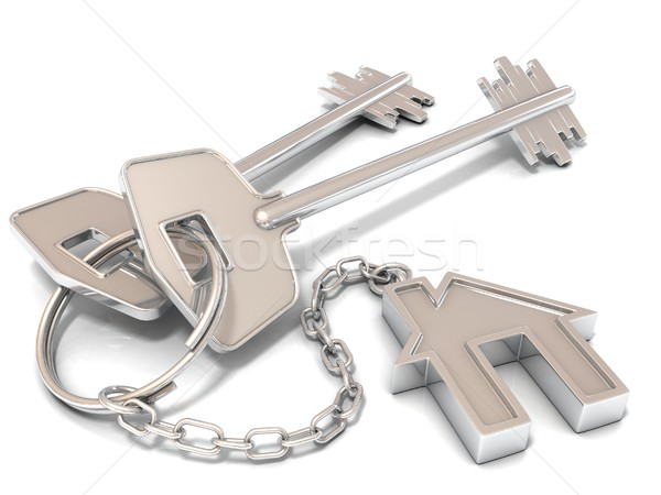 Stock photo: Two house door keys and house key-chain