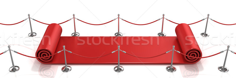Red carpet unrolling concept Stock photo © djmilic