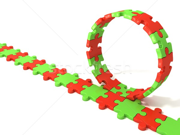 Puzzle ring rotating over puzzle chain Stock photo © djmilic