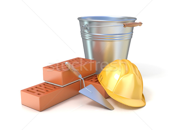Fragment of red brick wall, trowel, metal bucket and safety helm Stock photo © djmilic