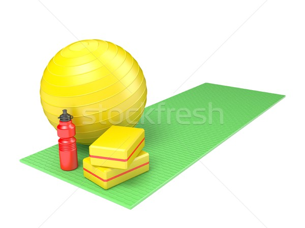 Fitness ball, gym block and plastic water bottle on green yoga m Stock photo © djmilic