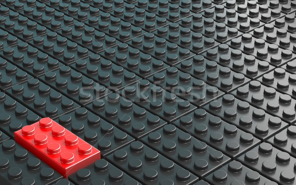 One red plastic brick toy on background made of black plastic br Stock photo © djmilic