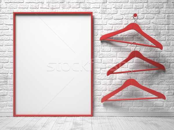 Three red cloth hanger and blank canvas Stock photo © djmilic