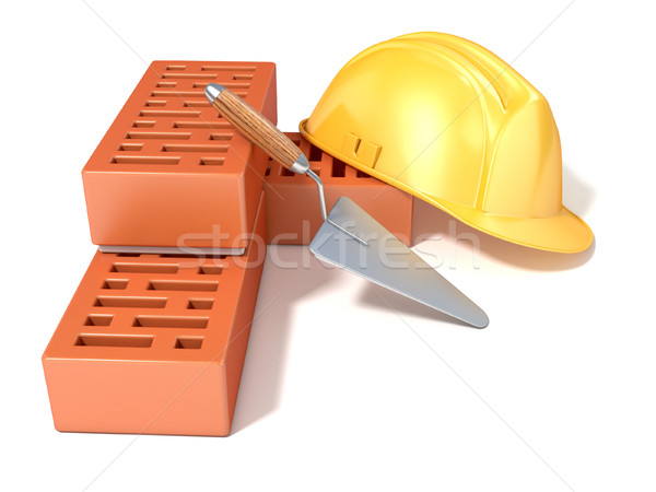 Safety helmet with rectangular perforated bricks and trowel. 3D Stock photo © djmilic