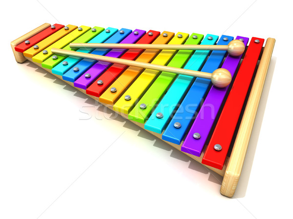Xylophone with rainbow colored keys and with two wood drum stick Stock photo © djmilic