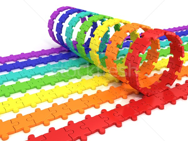 Colorful puzzle ring rotating over puzzle chain Stock photo © djmilic