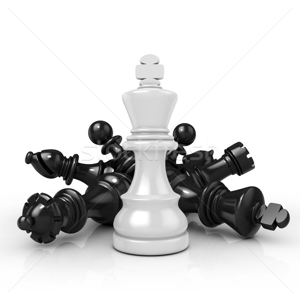 White king standing over fallen black chess pieces Stock photo © djmilic