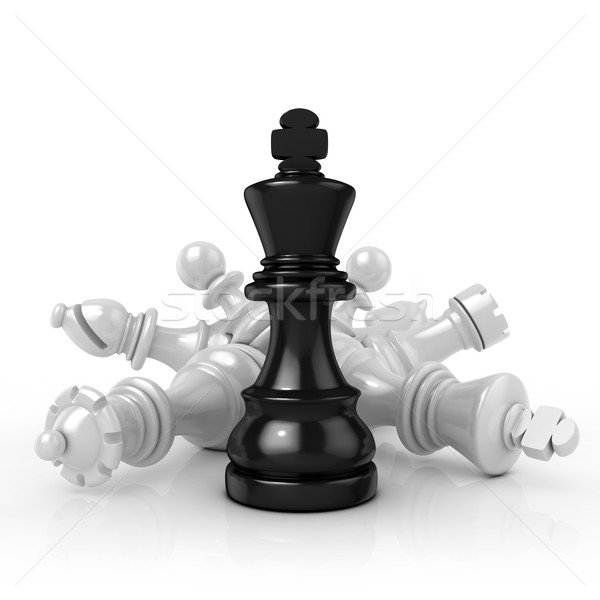 Black king standing over fallen black chess pieces Stock photo © djmilic