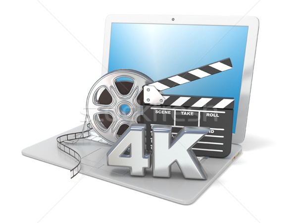 Laptop with film reels, movie clapper board and 4K video icon. 3 Stock photo © djmilic
