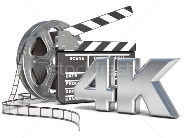 Film reels and movie clapper board. 4K video icon. 3D Stock photo © djmilic