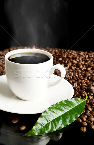 Cup of coffee,haze,green leaf and coffee beans on black Stock photo © dla4