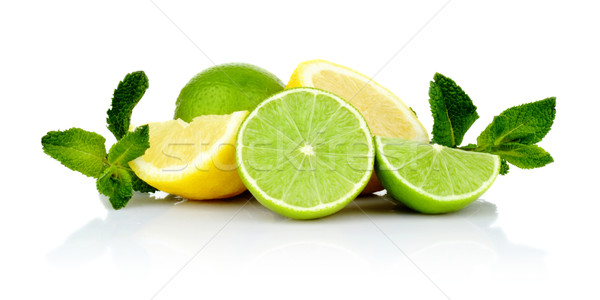 Three sliced lemons with limes with mint Stock photo © dla4
