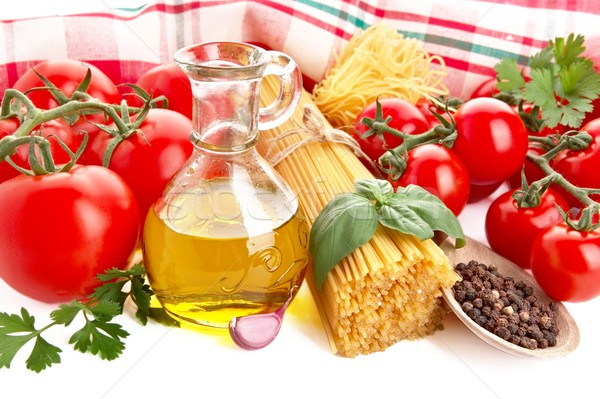 Photo of pasta with tomatoes,basil,oil,garlic at the top on white Stock photo © dla4