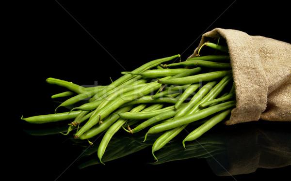 Boglya zöldbab vászon zsák fekete háttér Stock fotó © dla4