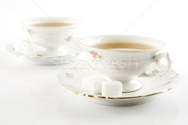 Old-style vintage two cups of tea on white background Stock photo © dla4