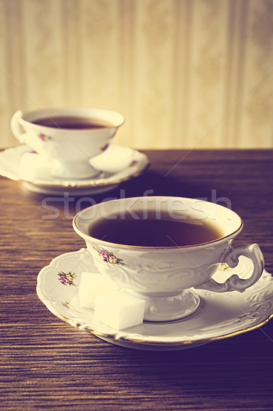Old-fashioned image with two cups of tea vintage effect Stock photo © dla4