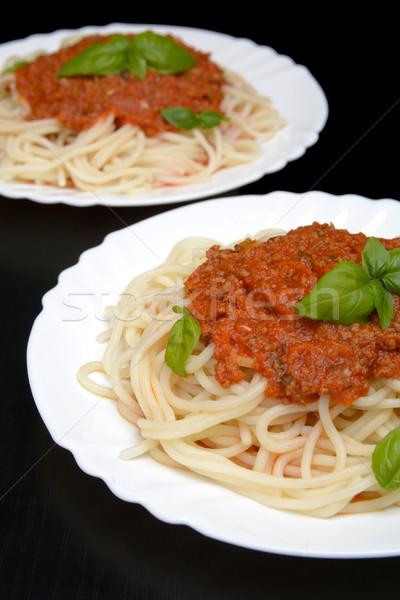 два блюдо пасты соус болоньезе черный ужин Сток-фото © dla4