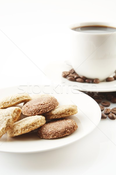 Cup of coffee with cookies and saucer on white Stock photo © dla4