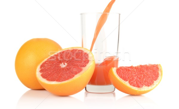 Studio shot sliced grapefruits with poured juice on white Stock photo © dla4