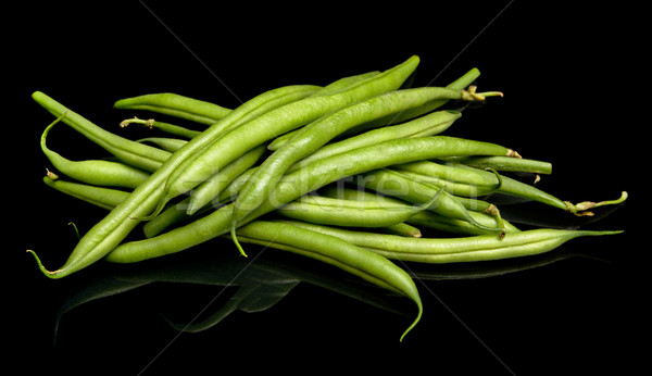 Group of green beans on black background Stock photo © dla4