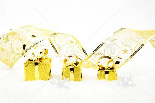 Dorado Navidad regalos cinta nieve decoración Foto stock © dla4
