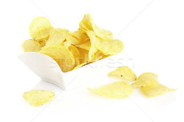 Salted potato crisps in the bowl on white background Stock photo © dla4